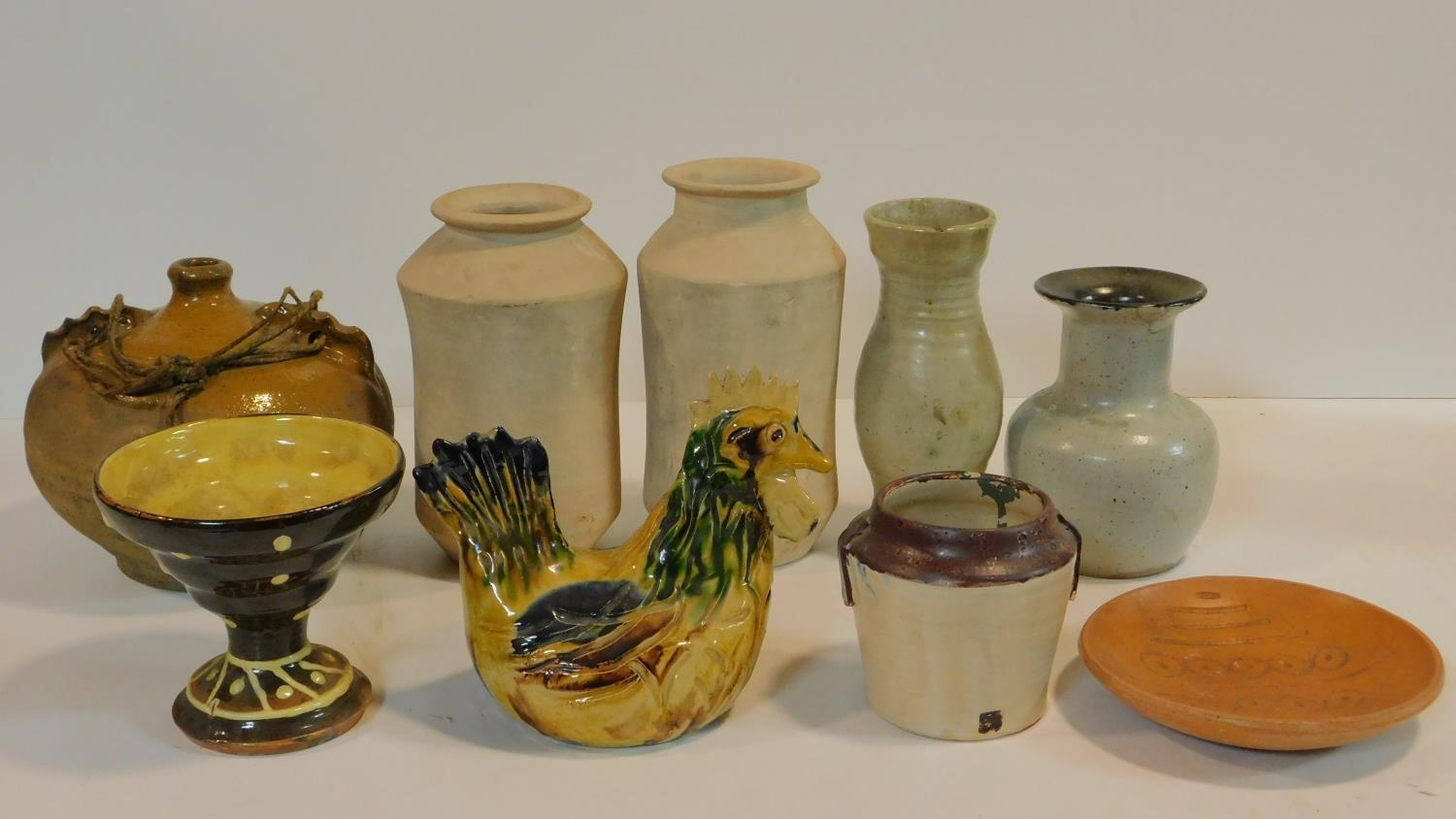 A miscellaneous collection of studio pottery, various jars, a bowl, ceramic chicken and a
