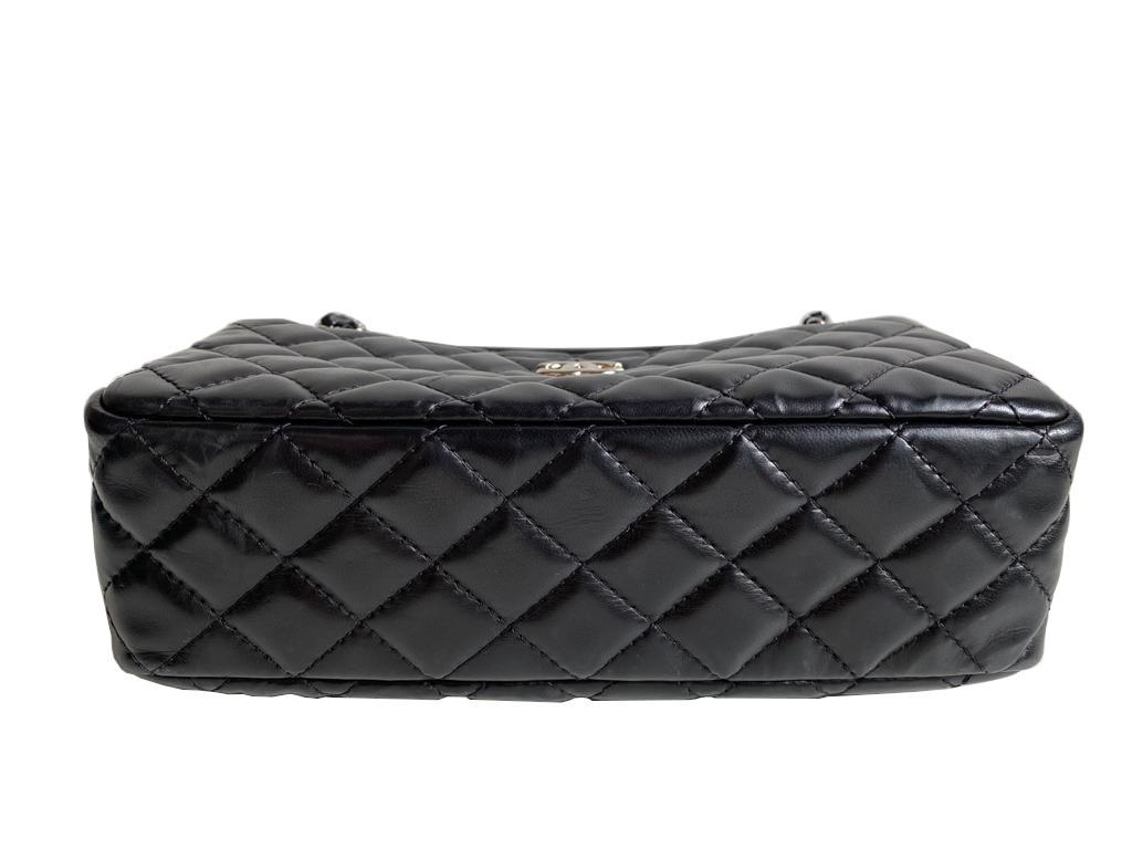 A Chanel Classic Camera Case in Black Lambskin with Silver Hardware, takes design inspiration from - Image 8 of 8