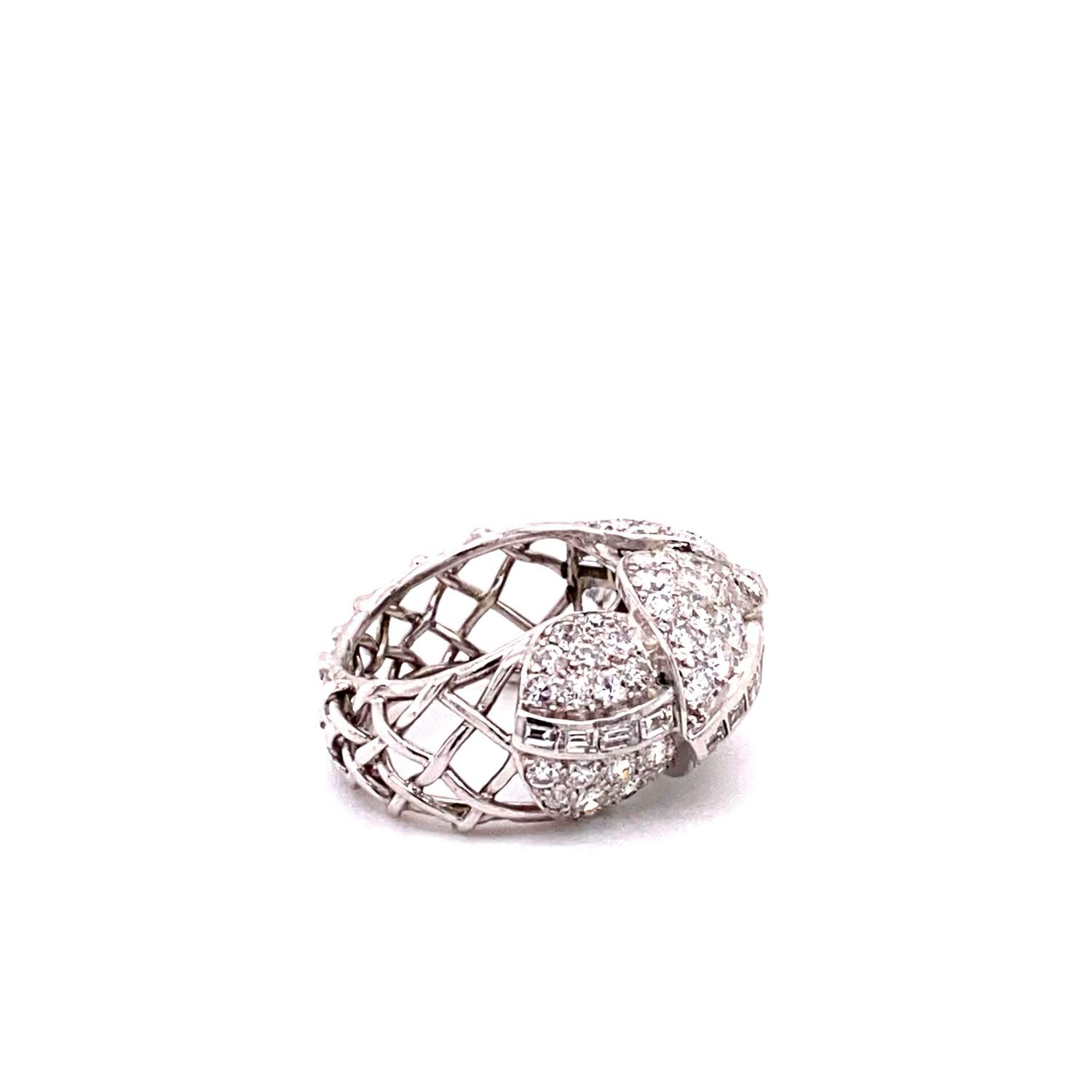 A 1950's Cartier Cocktail Ring, Cartier baguette and brilliant cut pave set dome top bombe ring