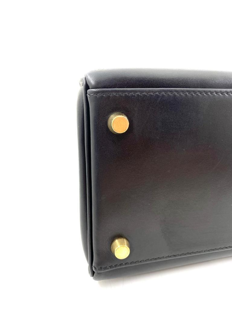 A black Hermes Kelly in box leather with gold hardware, includes Dustbag, Lock, Clochette & Strap. - Image 7 of 9