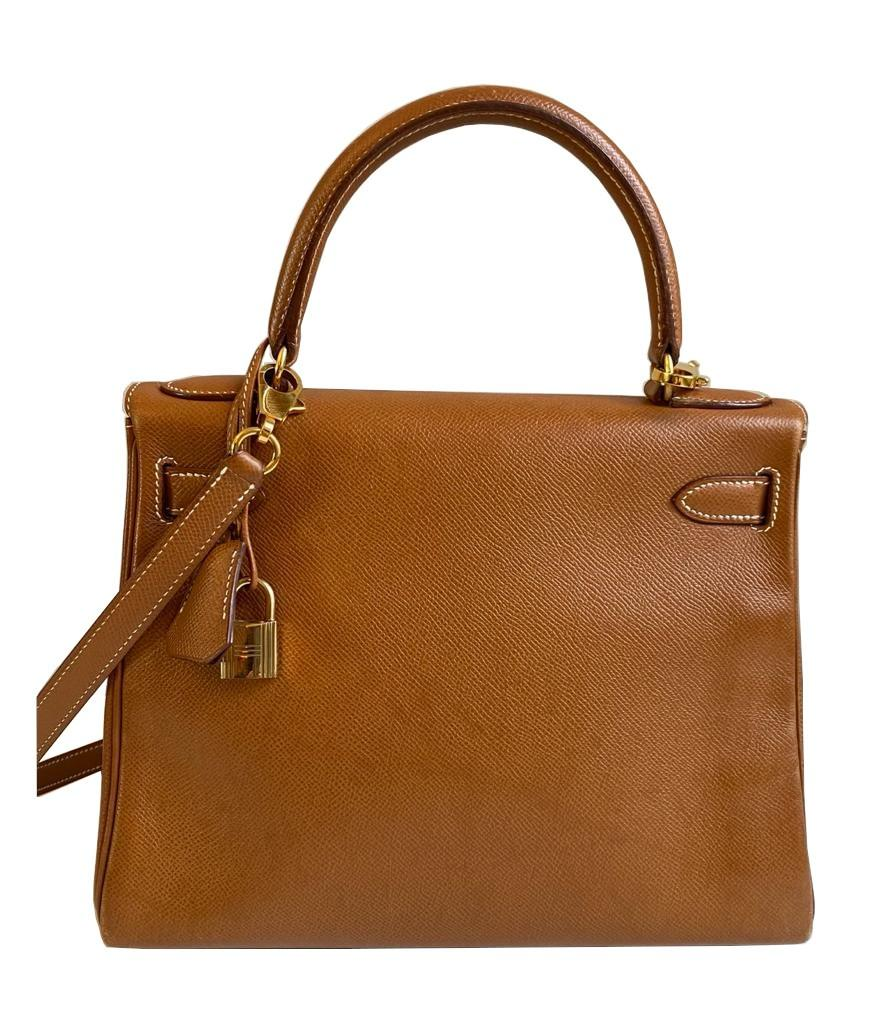 A gold Hermes Kelly in Courcheval leather with gold hardware, including Strap, Key, Lock and - Image 2 of 11