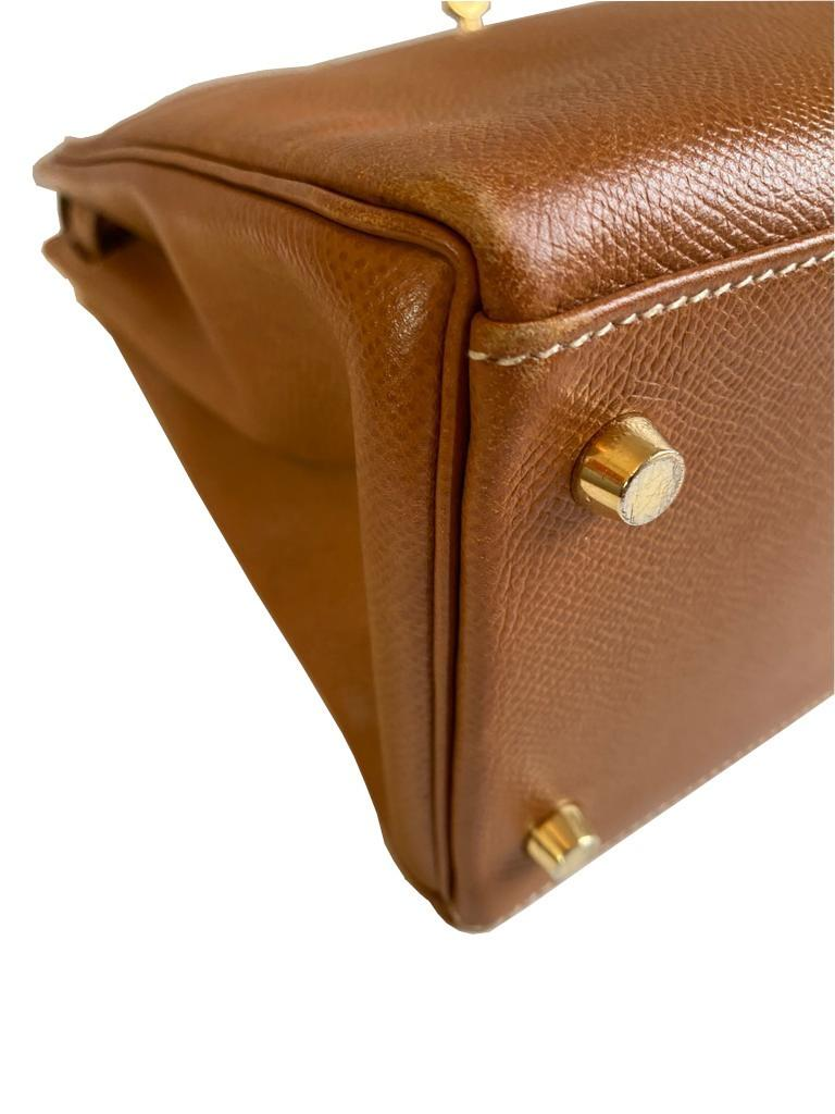 A gold Hermes Kelly in Courcheval leather with gold hardware, including Strap, Key, Lock and - Image 9 of 11