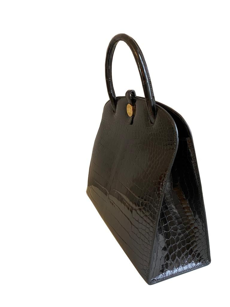 A Hermes Dalvy in black shiny crocodile with gold hardware and orange dustbag. W.30 x H.23 x D.10cm, - Image 4 of 9