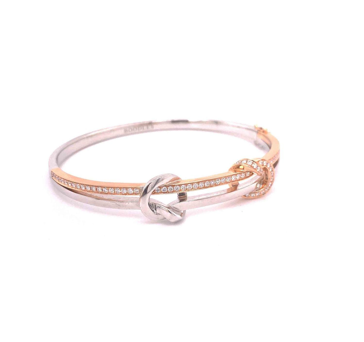 A Boodles diamond Love Knot bangle mounted in 18ct white and rose gold. Signed Boodles. London, - Image 4 of 5