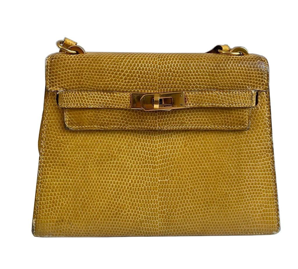 A yellow Hermes Kelly in Lizard with gold hardware, including strap. W.20cm x H.14cm x D.9cm,