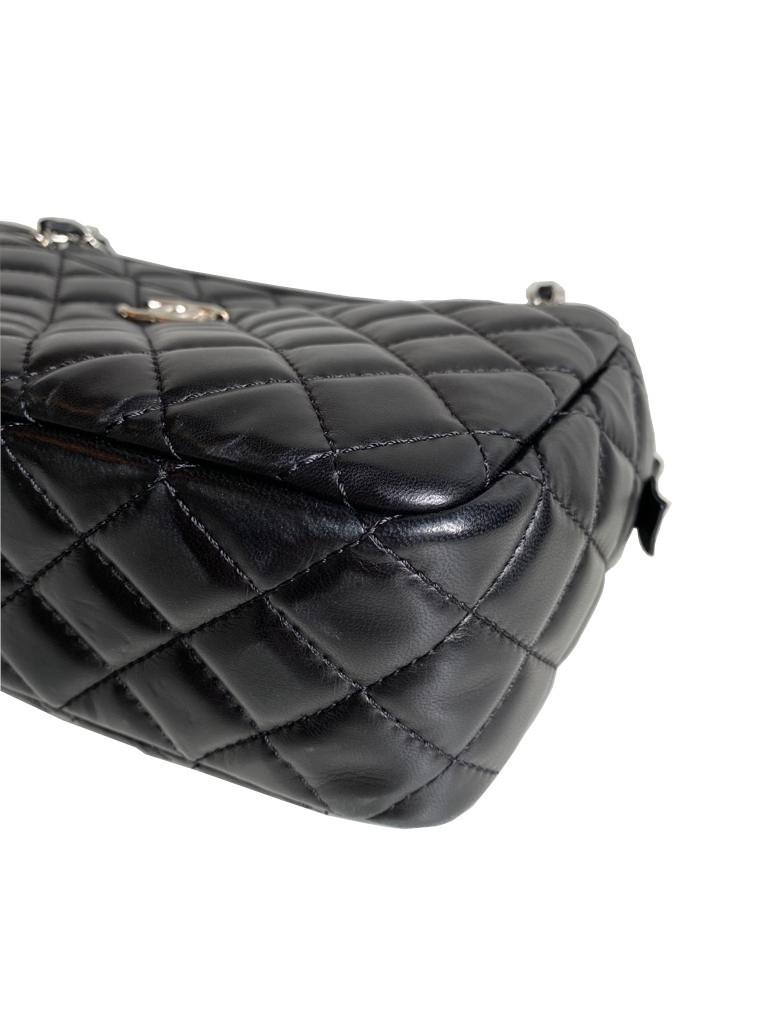 A Chanel Classic Camera Case in Black Lambskin with Silver Hardware, takes design inspiration from - Image 7 of 8