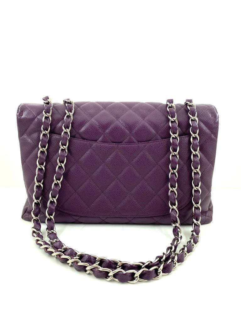 A Chanel Classic Flap Bag Jumbo in Purple Caviar with Silver Hardware, is instantly recognizable - Image 6 of 6