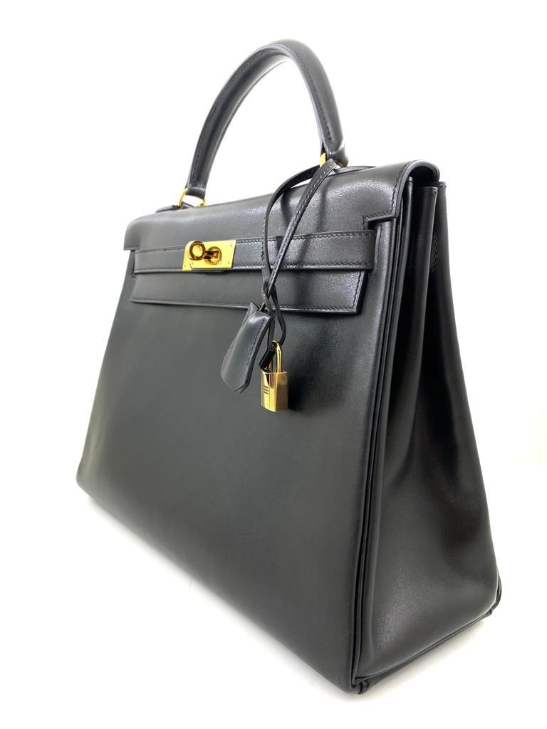 A black Hermes Kelly in box leather with gold hardware, includes Dustbag, Lock, Clochette & Strap. - Image 2 of 9