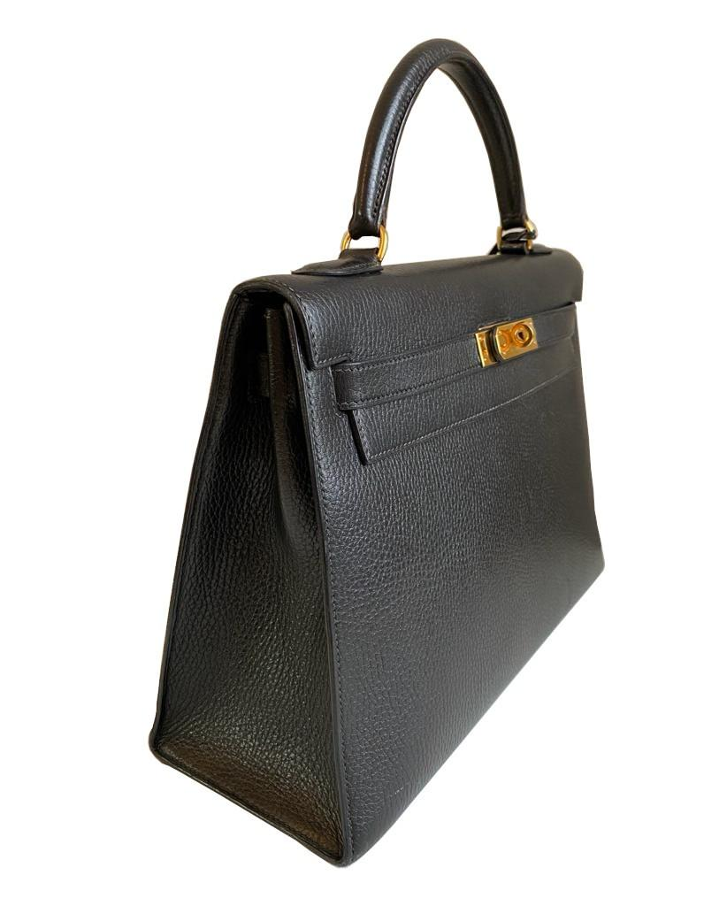 A black Hermes Kelly in Evergrain leather with gold hardware, includes Dustbag, Key (no lock), - Image 3 of 9