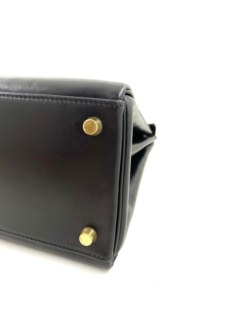A black Hermes Kelly in box leather with gold hardware, includes Dustbag, Lock, Clochette & Strap. - Image 6 of 9