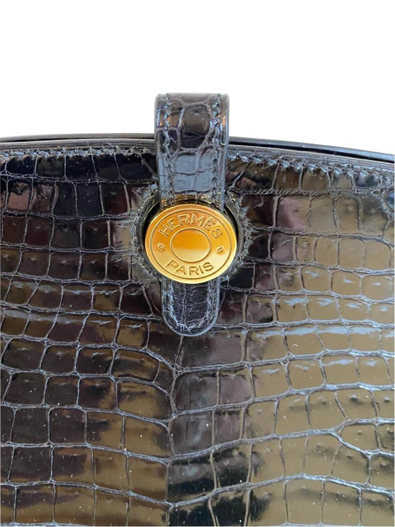 A Hermes Dalvy in black shiny crocodile with gold hardware and orange dustbag. W.30 x H.23 x D.10cm, - Image 6 of 9
