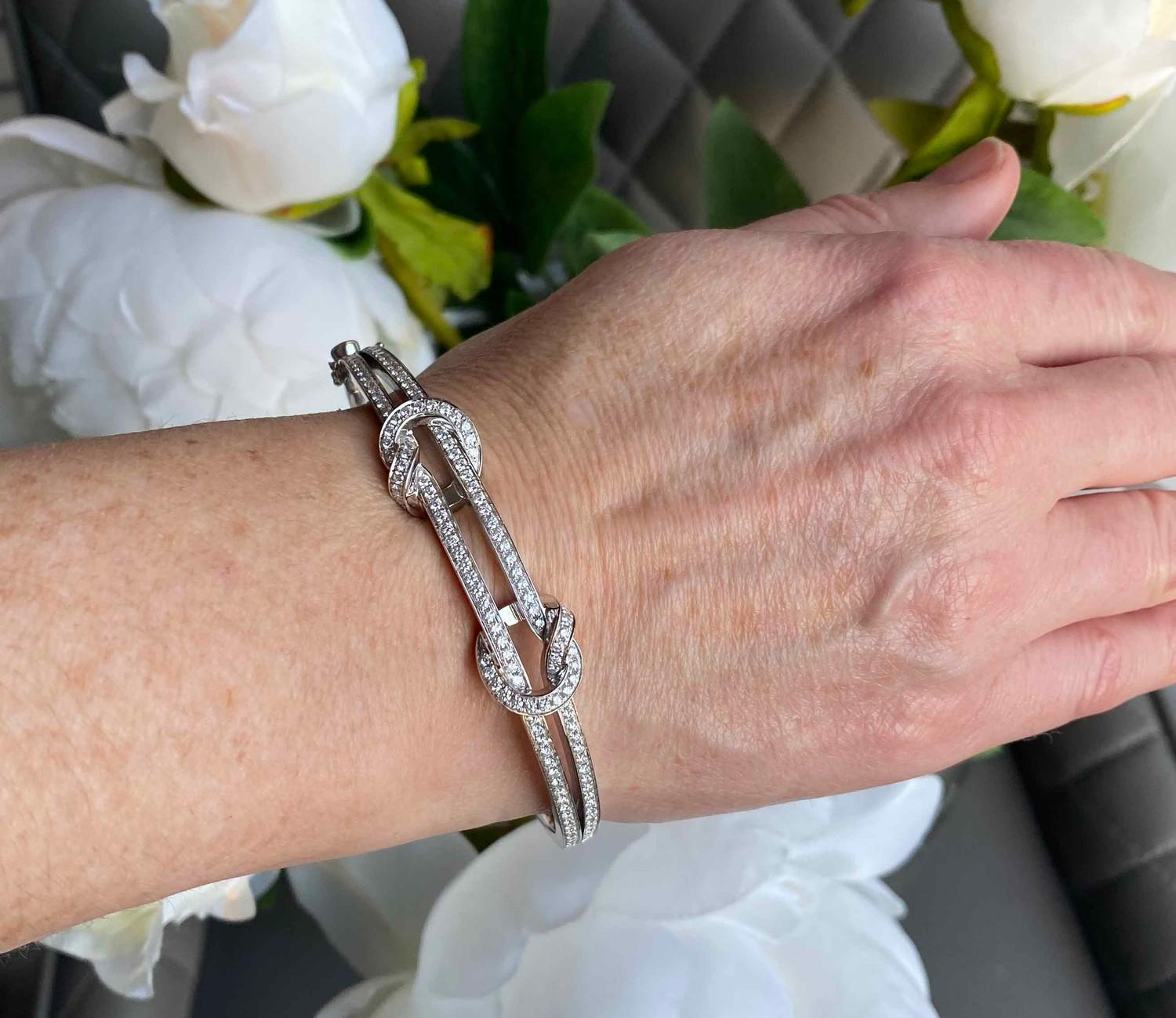 A Boodles diamond Love Knot bangle mounted in 18ct white gold. Signed Boodles, London, Contemporary. - Image 3 of 3
