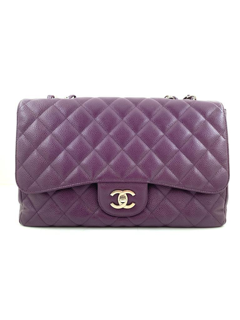 A Chanel Classic Flap Bag Jumbo in Purple Caviar with Silver Hardware, is instantly recognizable