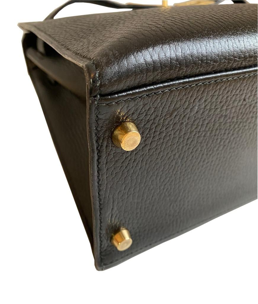 A black Hermes Kelly in Evergrain leather with gold hardware, includes Dustbag, Key (no lock), - Image 5 of 9