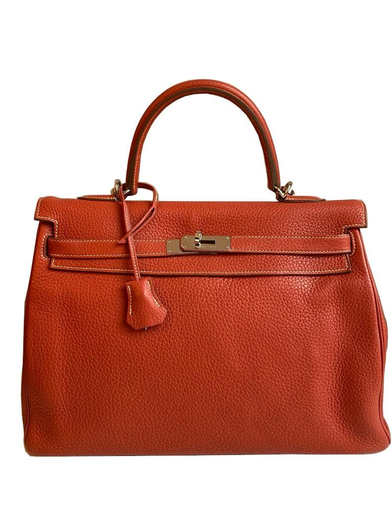 A sanguine Hermes Kelly in clemence leather with palladium hardware, includes Dustbag, Raincover,