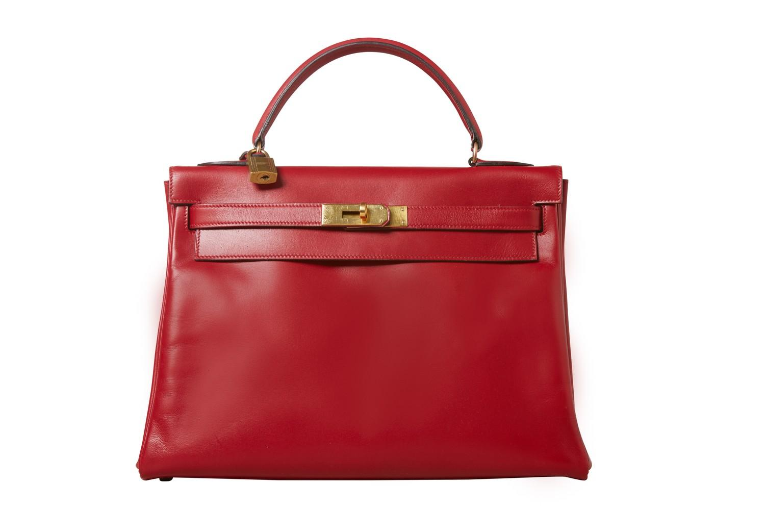 A red Hermes Kelly in tadelakt leather with gold hardware. W.32cm x H.23cm x D.10.5cm, stamped O (