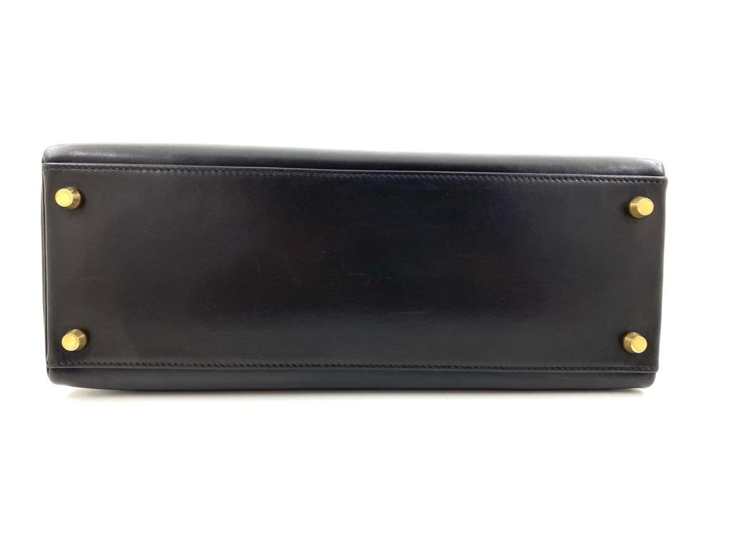 A black Hermes Kelly in box leather with gold hardware, includes Dustbag, Lock, Clochette & Strap. - Image 9 of 9