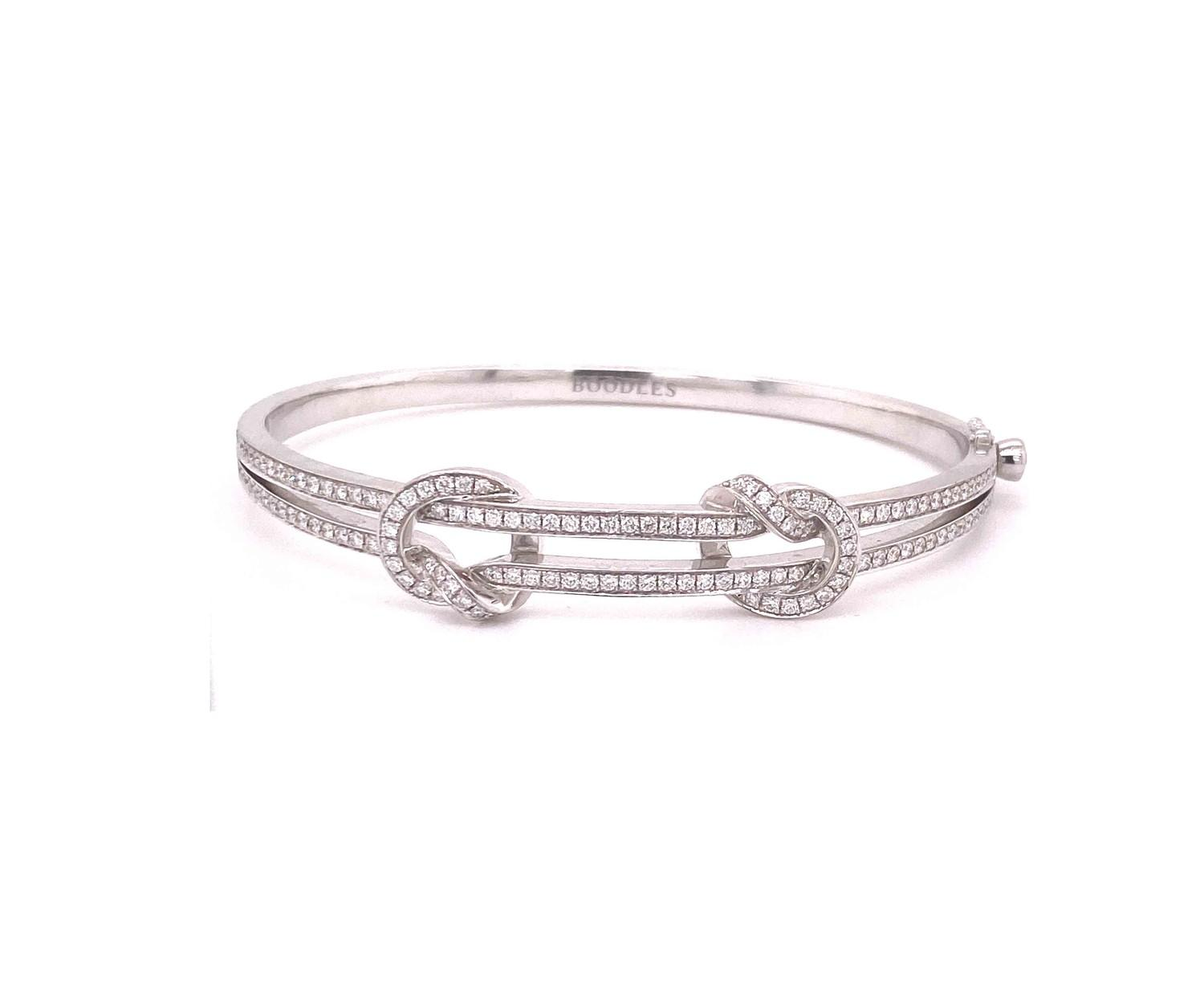 A Boodles diamond Love Knot bangle mounted in 18ct white gold. Signed Boodles, London, Contemporary. - Image 2 of 3