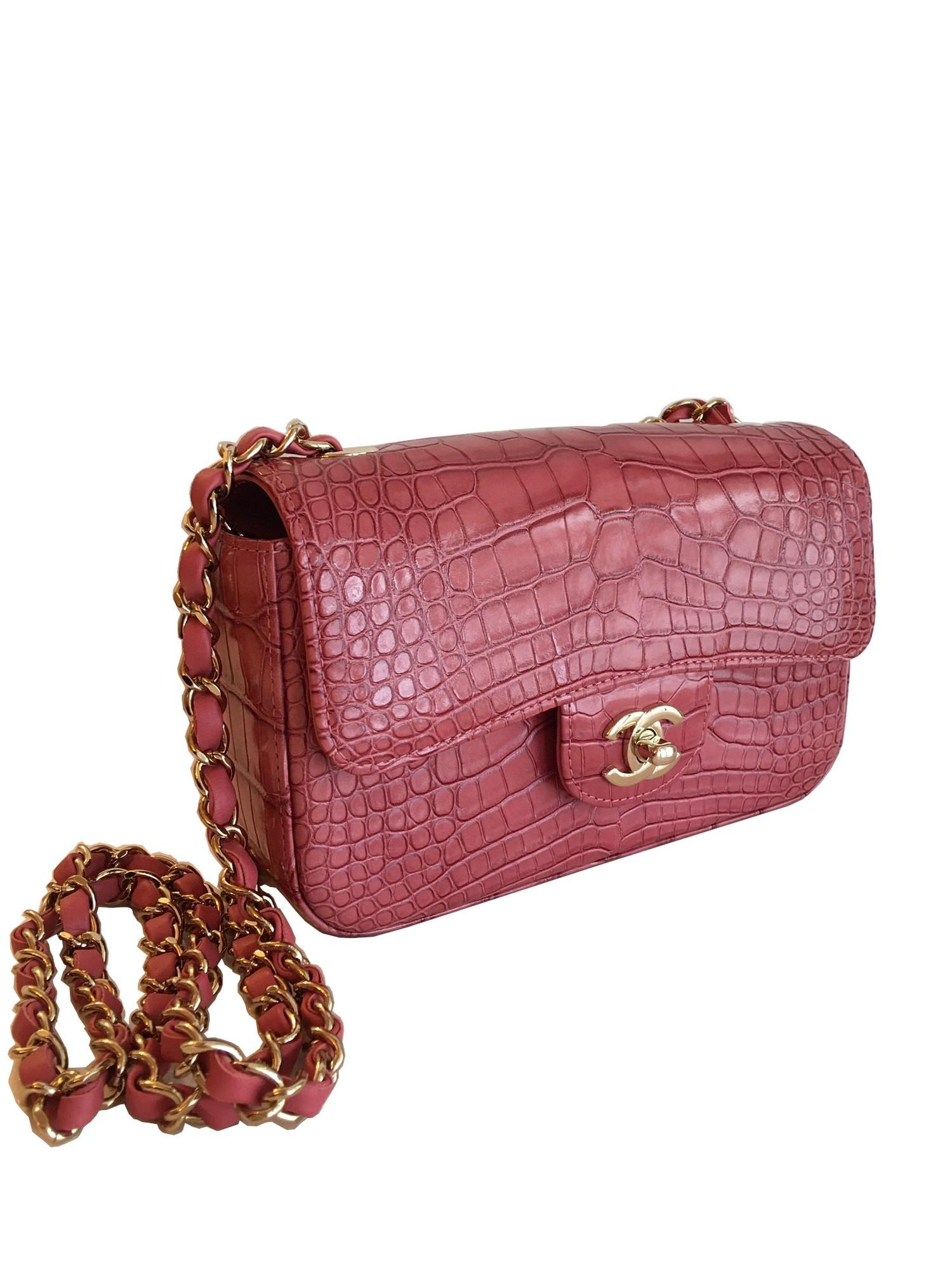 A Chanel Classic Flap in Dusky Pink Crocodile leather with Gold Hardware is instantly recognizable