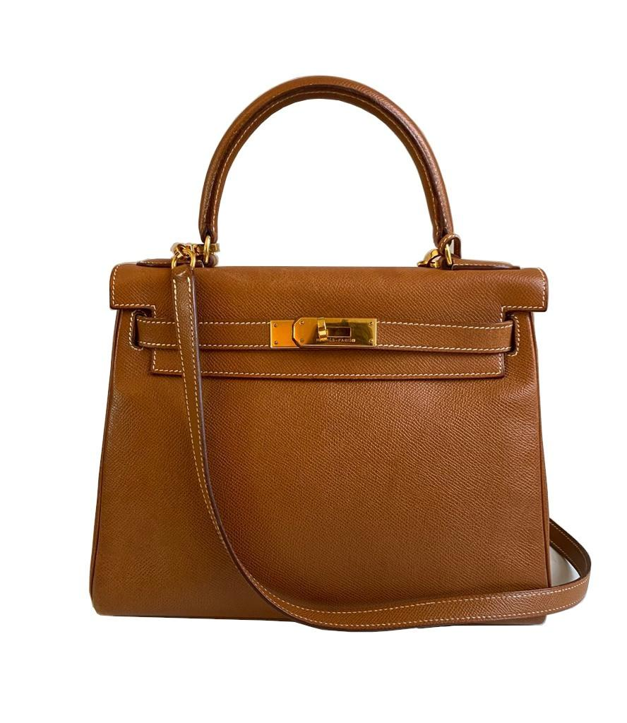 A gold Hermes Kelly in Courcheval leather with gold hardware, including Strap, Key, Lock and
