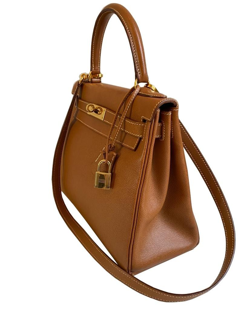 A gold Hermes Kelly in Courcheval leather with gold hardware, including Strap, Key, Lock and - Image 4 of 11