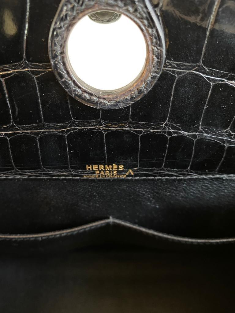 A Hermes Dalvy in black shiny crocodile with gold hardware and orange dustbag. W.30 x H.23 x D.10cm, - Image 9 of 9