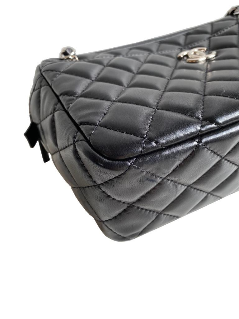 A Chanel Classic Camera Case in Black Lambskin with Silver Hardware, takes design inspiration from - Image 6 of 8