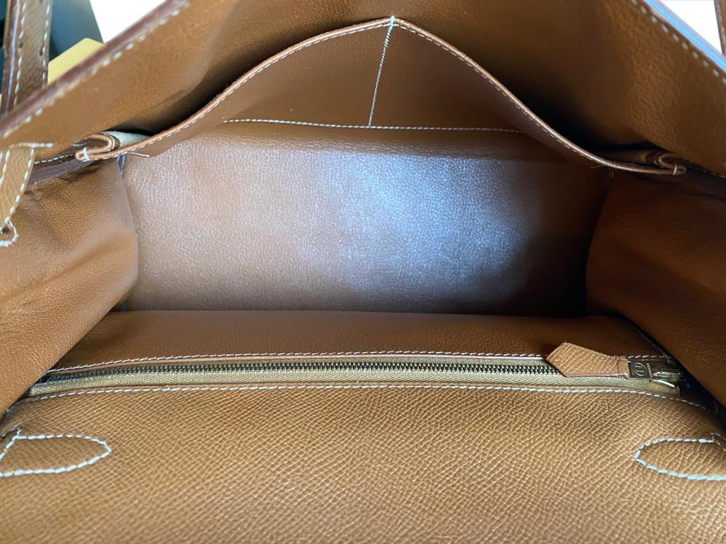 A gold Hermes Kelly in Courcheval leather with gold hardware, including Strap, Key, Lock and - Image 5 of 11