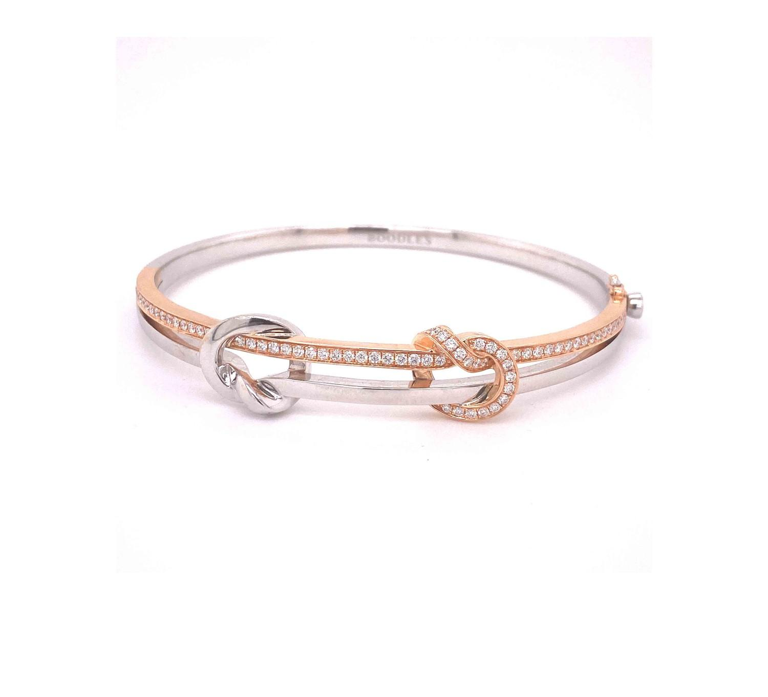 A Boodles diamond Love Knot bangle mounted in 18ct white and rose gold. Signed Boodles. London, - Image 2 of 5