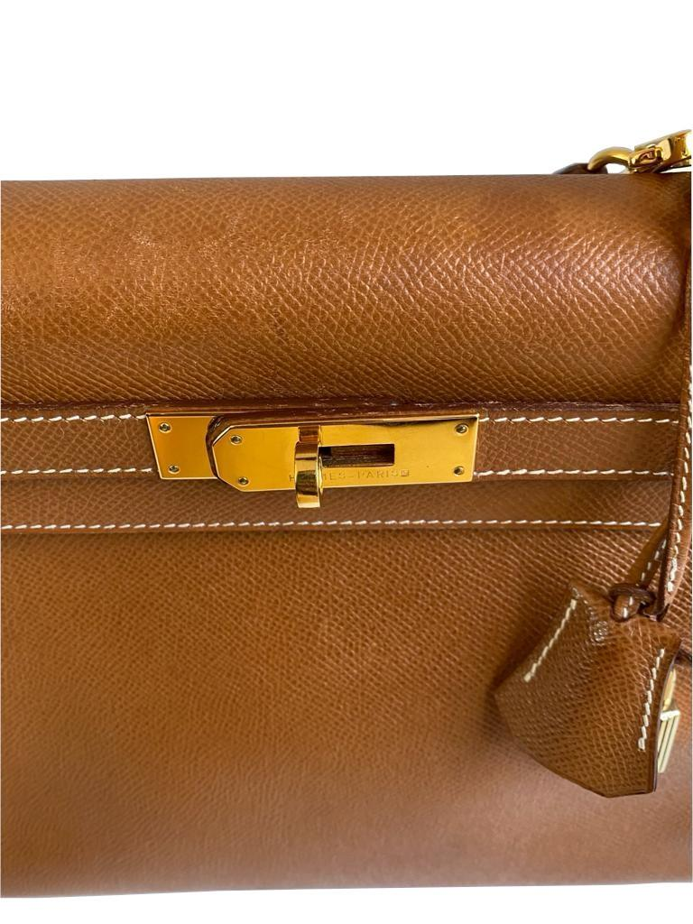 A gold Hermes Kelly in Courcheval leather with gold hardware, including Strap, Key, Lock and - Image 7 of 11