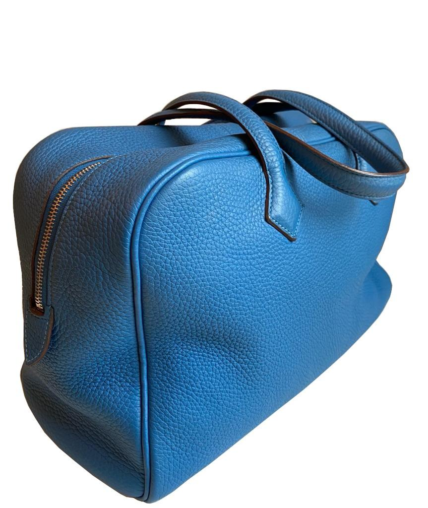 A Hermes Bleu de Galice Victoria II in clemence leather with palladium hardware, includes Dustbag.