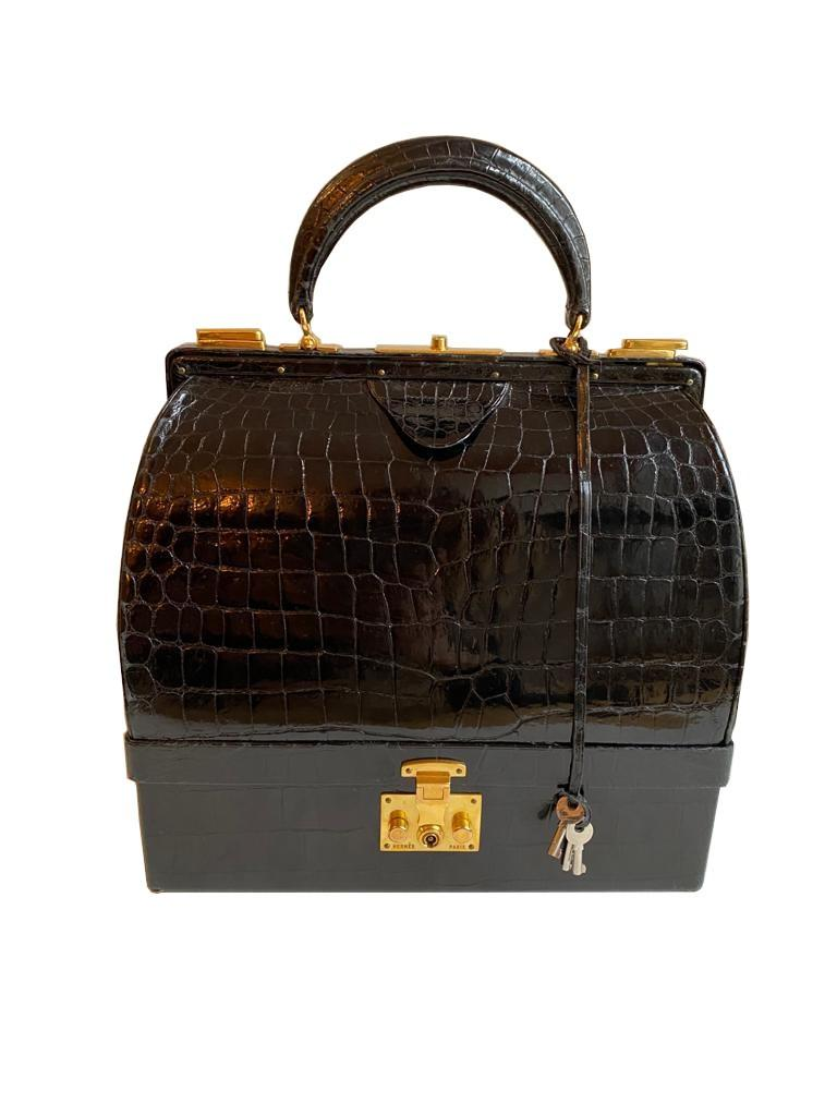 A Hermes Mallet bag in black shiny crocodile with gold hardware, includes Brown Dustbag, Keys &