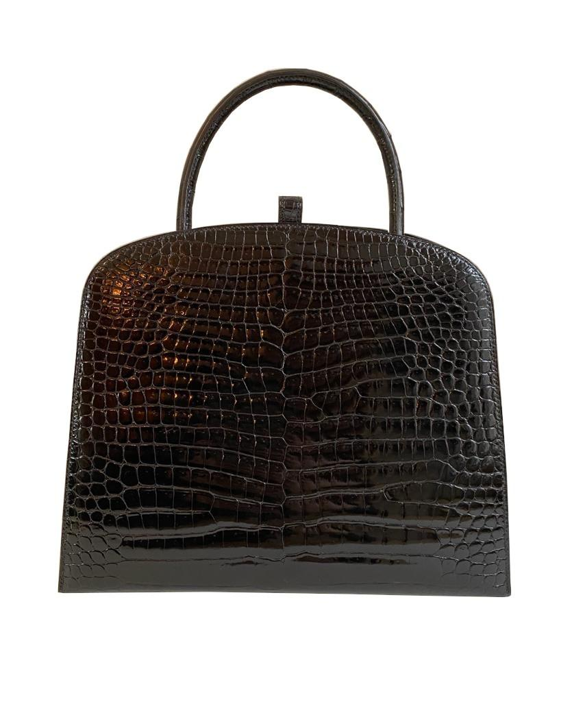 A Hermes Dalvy in black shiny crocodile with gold hardware and orange dustbag. W.30 x H.23 x D.10cm, - Image 2 of 9
