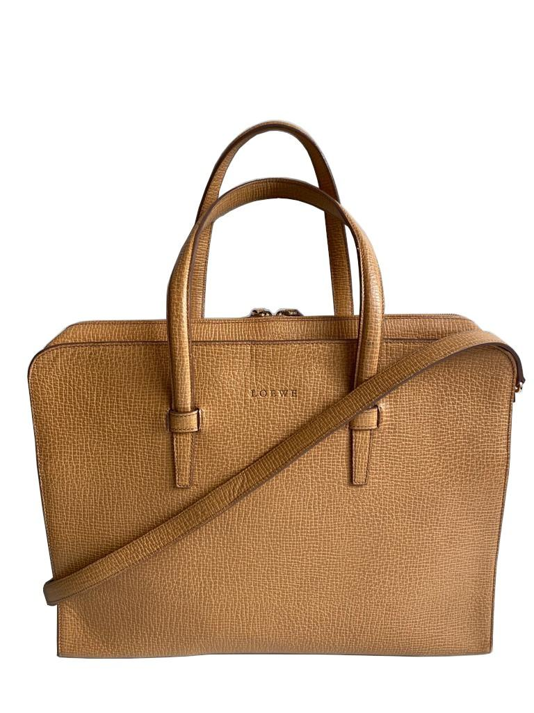 A Loewe Briefcase Handbag with Gold Hardware, might have been worn just once or twice. It's a very