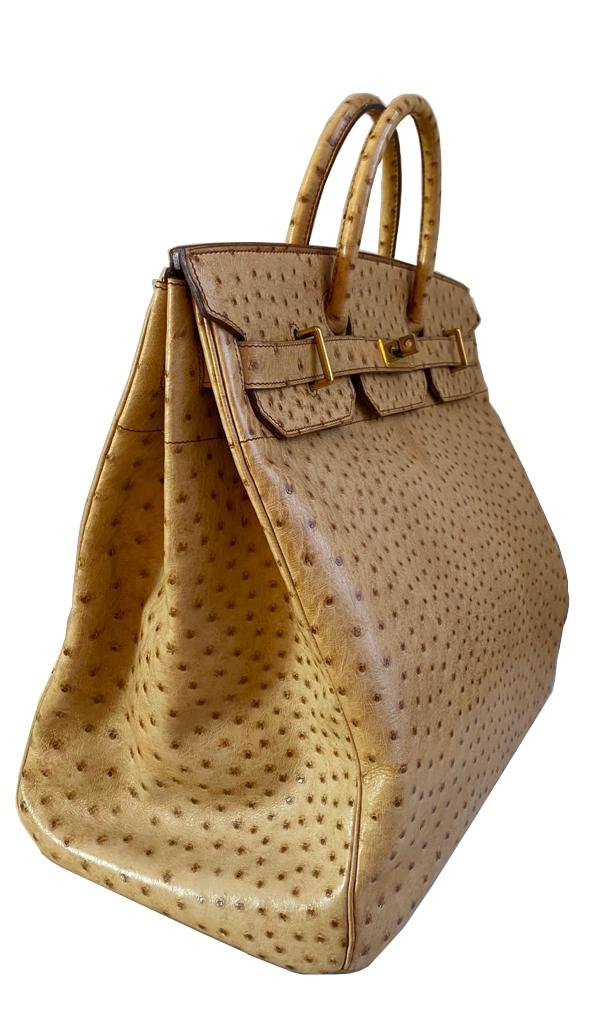 A gold Hermes Birkin Haut à Courroies (HAC) in ostrich leather with gold hardware, includes brown - Image 4 of 10