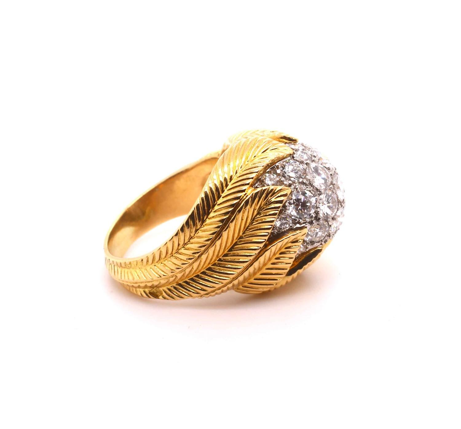 A Van Cleef & Aprel Cocktail Ring with a Pave set diamond flame ring mounted in an intricate