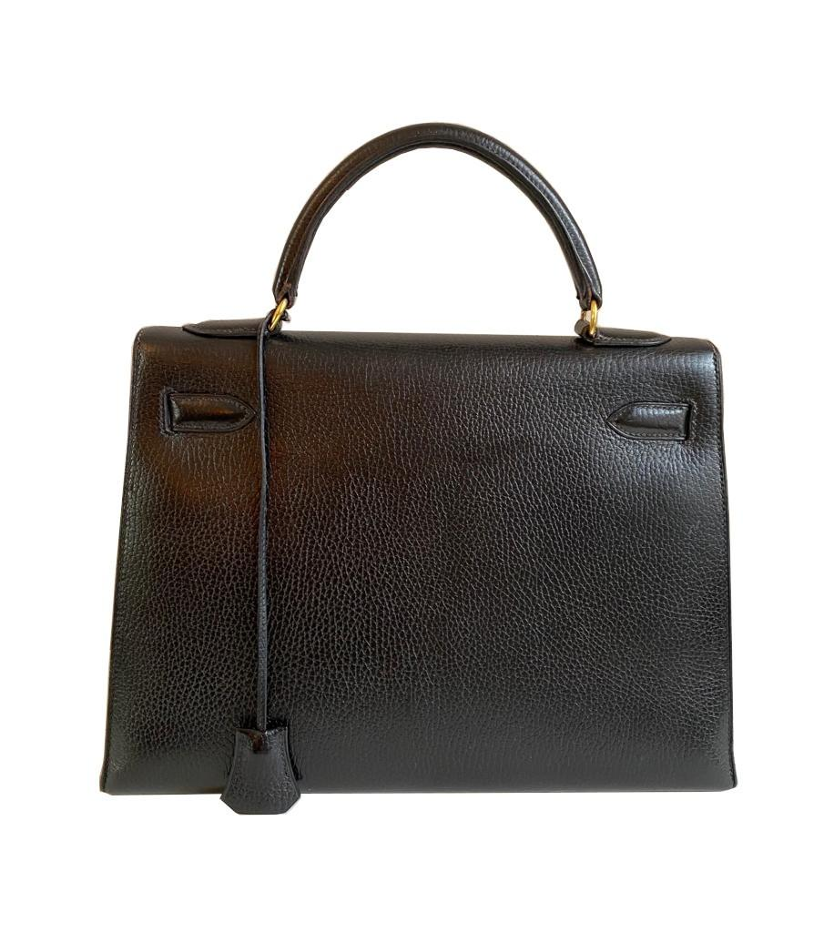A black Hermes Kelly in Evergrain leather with gold hardware, includes Dustbag, Key (no lock), - Image 4 of 9
