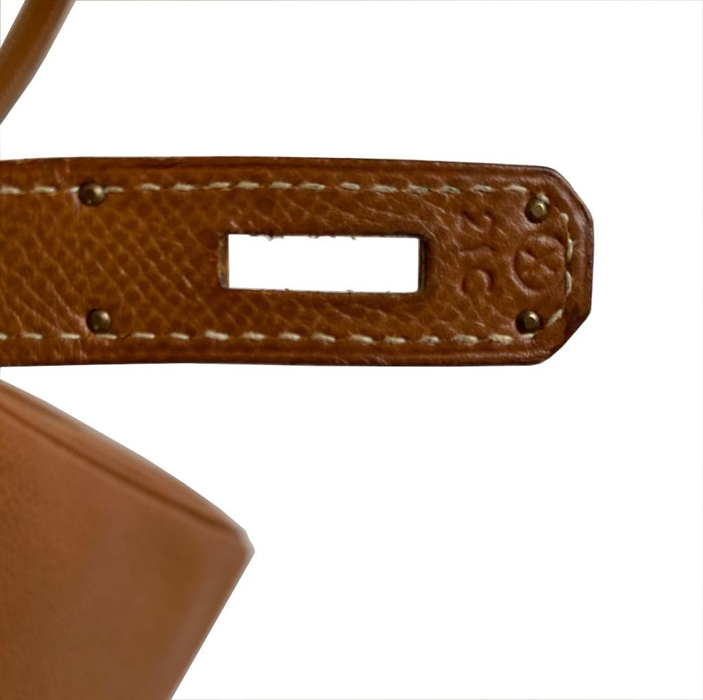 A gold Hermes Kelly in Courcheval leather with gold hardware, including Strap, Key, Lock and - Image 6 of 11
