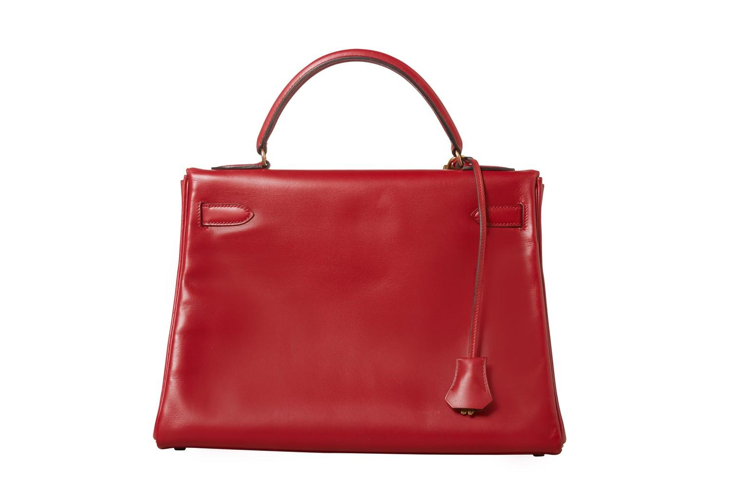 A red Hermes Kelly in tadelakt leather with gold hardware. W.32cm x H.23cm x D.10.5cm, stamped O ( - Image 2 of 7