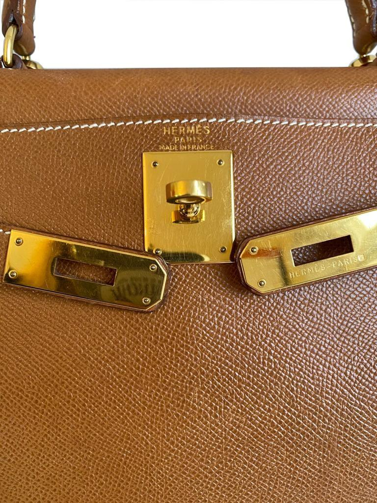 A gold Hermes Kelly in Courcheval leather with gold hardware, including Strap, Key, Lock and - Image 11 of 11