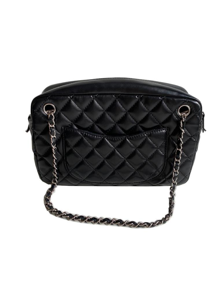 A Chanel Classic Camera Case in Black Lambskin with Silver Hardware, takes design inspiration from - Image 2 of 8