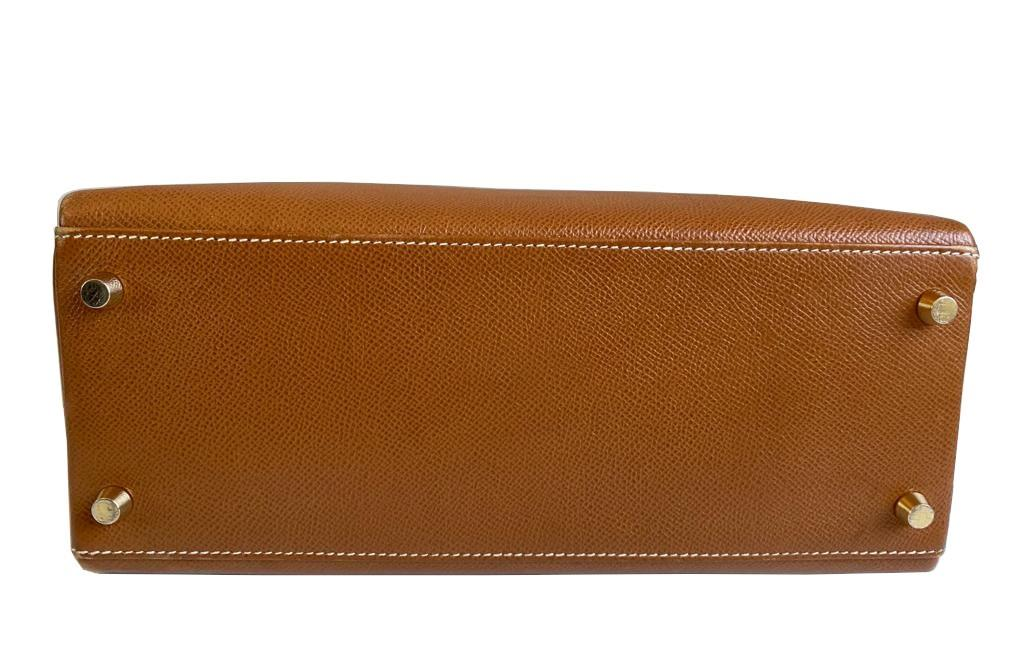 A gold Hermes Kelly in Courcheval leather with gold hardware, including Strap, Key, Lock and - Image 8 of 11
