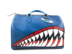 A Louis Vuitton Speedy 30 in Toledo Blue Epi Leather has rolled handles, a top zip closure and an