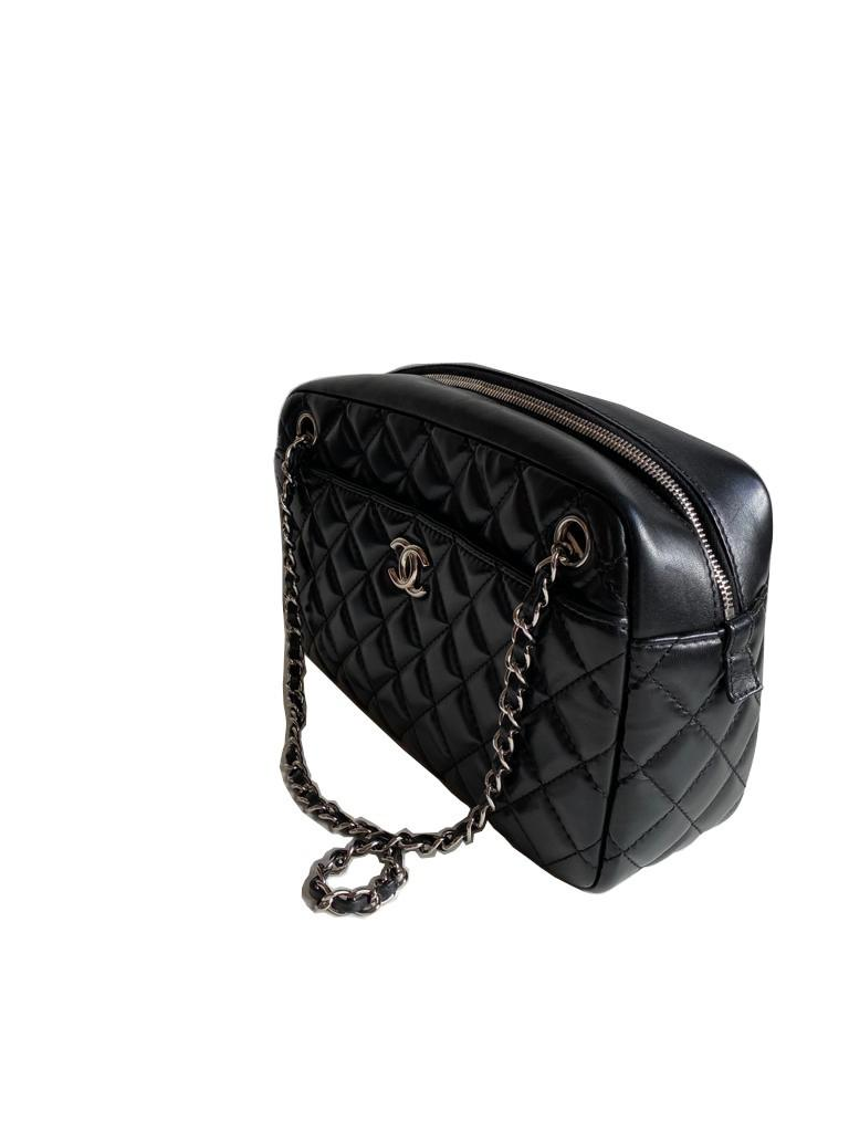 A Chanel Classic Camera Case in Black Lambskin with Silver Hardware, takes design inspiration from - Image 4 of 8