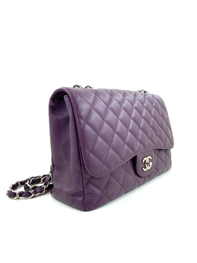 A Chanel Classic Flap Bag Jumbo in Purple Caviar with Silver Hardware, is instantly recognizable - Image 5 of 6