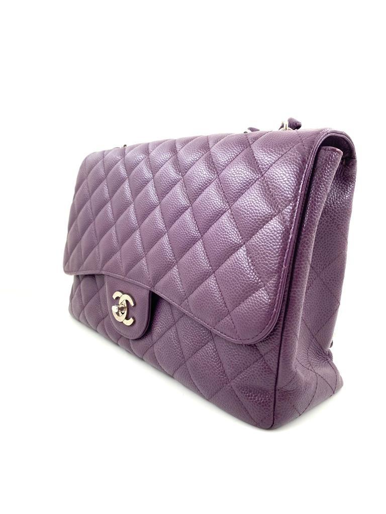 A Chanel Classic Flap Bag Jumbo in Purple Caviar with Silver Hardware, is instantly recognizable - Image 4 of 6