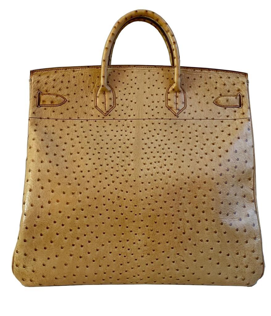 A gold Hermes Birkin Haut à Courroies (HAC) in ostrich leather with gold hardware, includes brown - Image 2 of 10