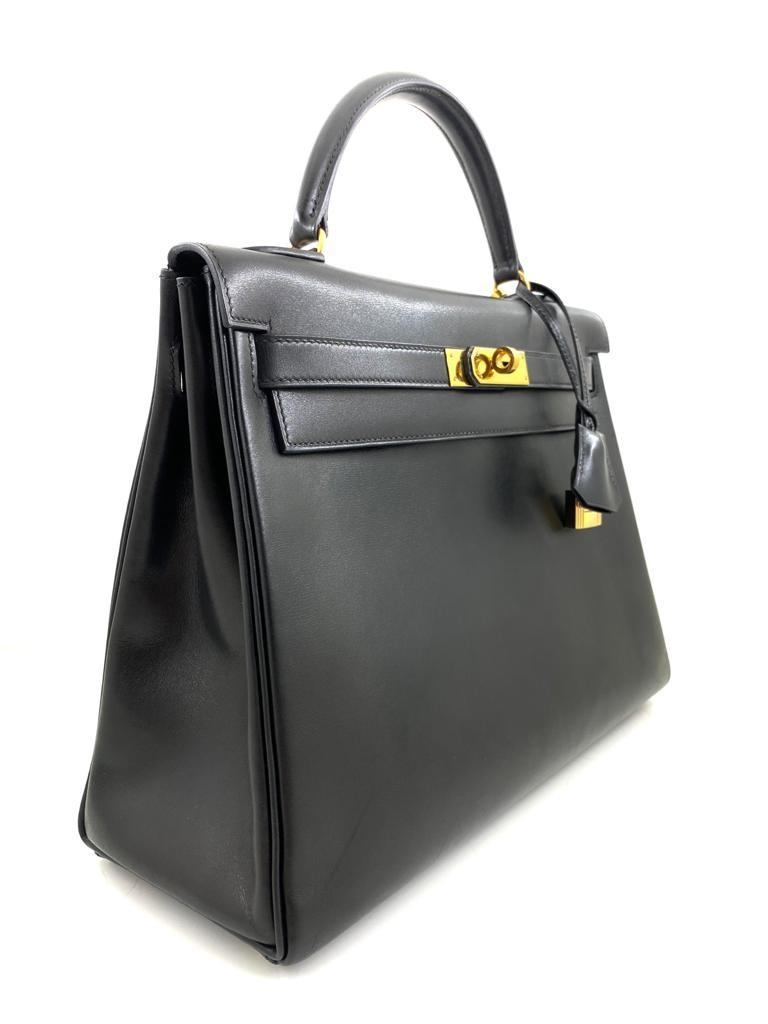 A black Hermes Kelly in box leather with gold hardware, includes Dustbag, Lock, Clochette & Strap. - Image 3 of 9