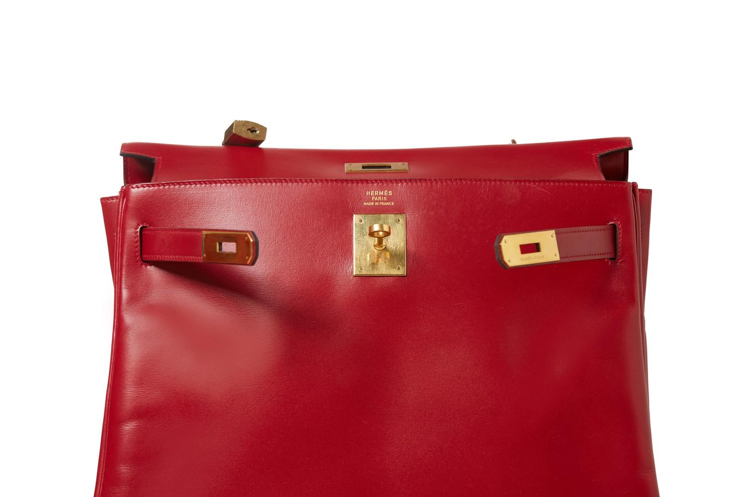 A red Hermes Kelly in tadelakt leather with gold hardware. W.32cm x H.23cm x D.10.5cm, stamped O ( - Image 3 of 7