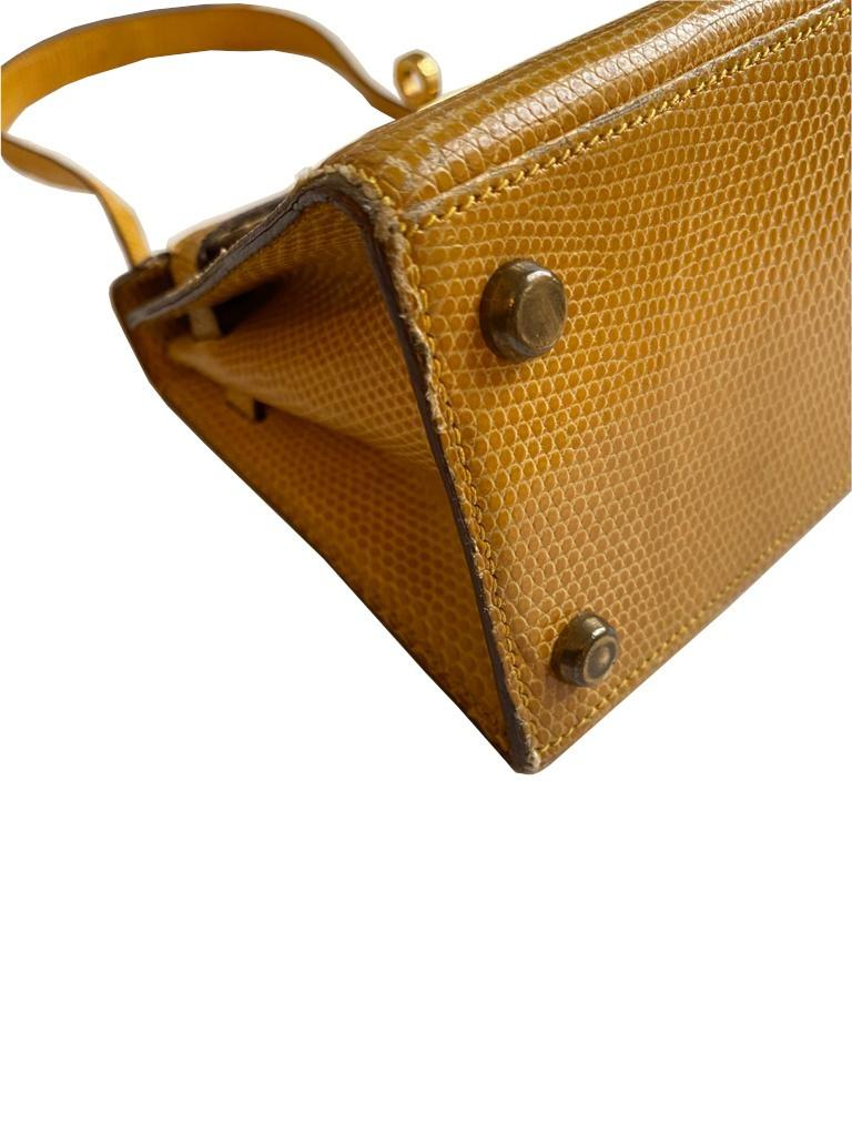 A yellow Hermes Kelly in Lizard with gold hardware, including strap. W.20cm x H.14cm x D.9cm, - Image 8 of 11